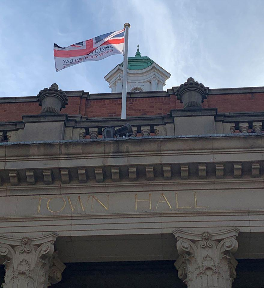 Picture showing Armed forces Day Flag flying on Town Hall