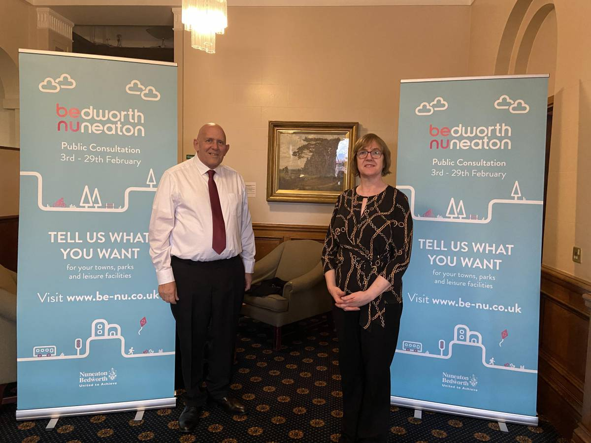 Julie Jackson and Ian Lloyd standing next to consultation banners