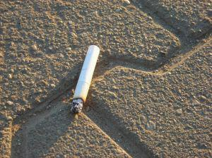Cigarette butt littered on concrete floor